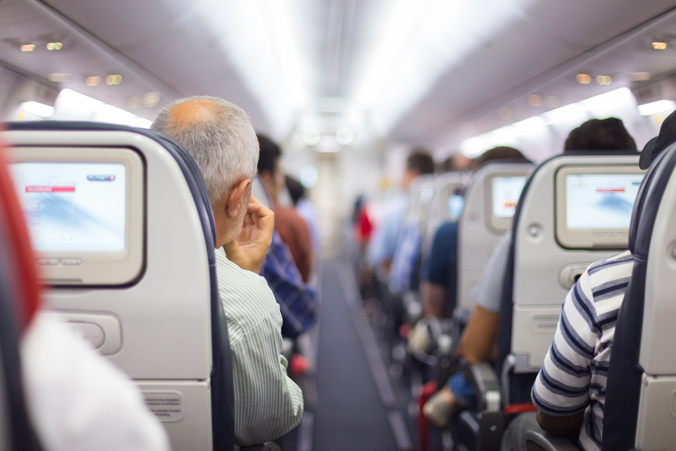 Photo of people on an airplane.