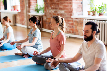 Photo of group of people practicing yoga
