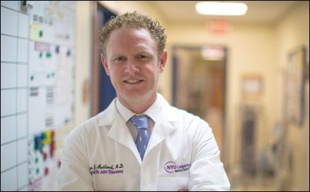 Aaron J. Buckland, MD