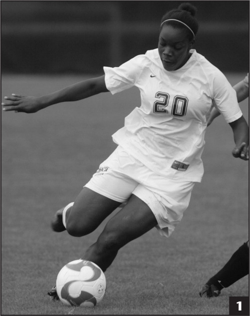 Female soccer player displaying rotational force.