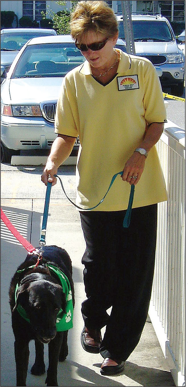 Lin Buettner was an instructor and team evaluator for Delta Society's Pet Partners, for which Boo was an animal-assisted therapy dog.Photo courtesy of Suzanne Fitzsimmons, MS, ARNP