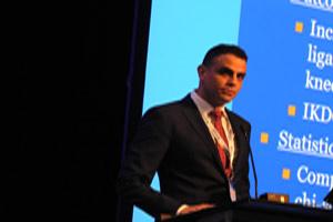 Hythman Salem at AOSSM podium