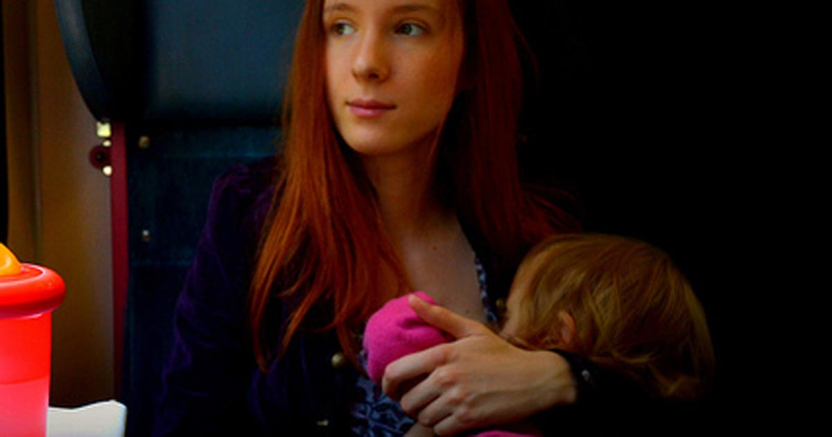 Mother breastfeeding infant